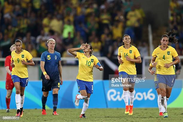 Marta of Brazil celebrates after scoring Brazil's third goal during the Women's Group E first round match between Brazil and Sweden on Day 1 of the...