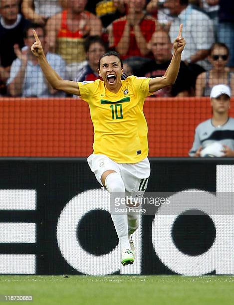 Marta of Brazil celebrates after scoring their second goal during the Women's World Cup Quarter Final match between Brazil and USA at RudolfHarbig...