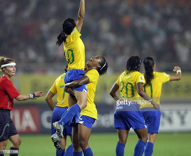 Marta of Brazil celebrates with a teammate after scoring a goal in their semifinal match against the US in the FIFA Women's World Cup football...