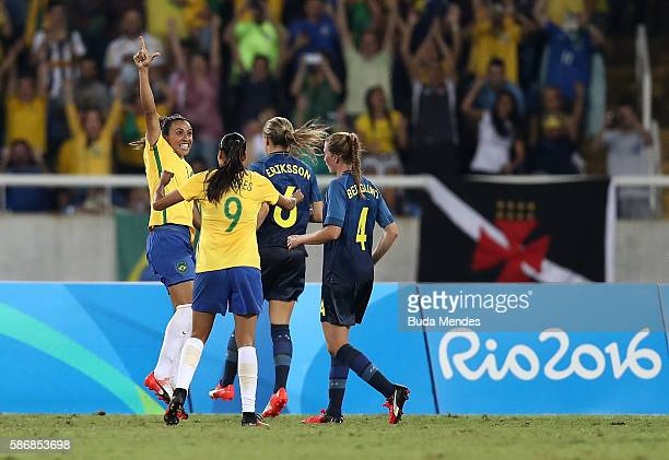 Marta of Brazil celebrates with teammate Andressa Alves after scoring Brazil's third goal during the Women's Group E first round match between Brazil...