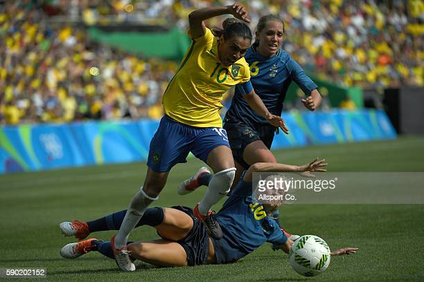 Marta of Brazil clashes with Elin Rubensson of Sweden during the Women's Football Semi Final between Brazil and Sweden on Day 11 of the Rio 2016...