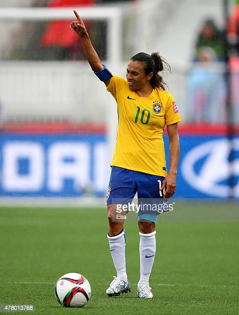 Marta of Brazil directs her teammates before a kick in the second half against Australia during the FIFA Women's World Cup 2015 round of 16 match...