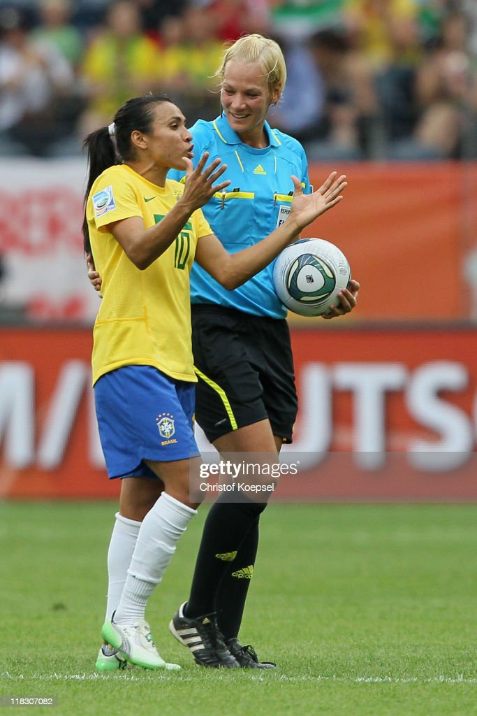 Marta of Brazil discusses with referee <a gi-track='captionPersonalityLinkClicked' href=/galleries/search?phrase=Bibiana+Steinhaus&family=editorial&specificpeople=2299795 ng-click='$event.stopPropagation()'>Bibiana Steinhaus</a> of Germany during the FIFA Women's World Cup 2011 Group D match between Equatorial Guinea and Brazil at FIFA World Cup stadium Frankfurt on July 6, 2011 in Frankfurt am Main, Germany.