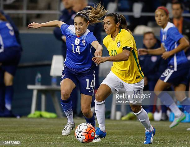 Marta of Brazil dribbles against Morgan Brian of the United States in the second half at CenturyLink Field on October 21 2015 in Seattle Washington