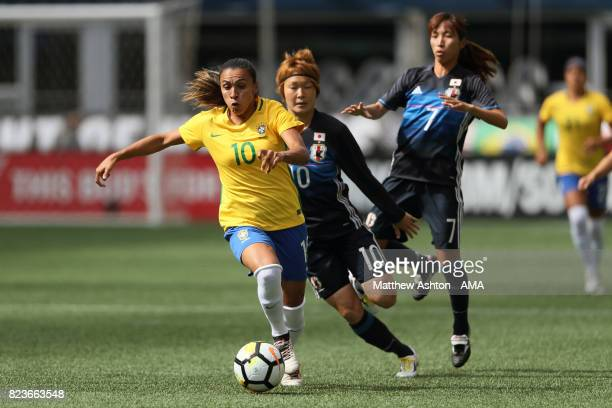 Marta of Brazil gets past Mizuho Sakaguchi and Emi Nakajima of Japan during the 2017 Tournament Of Nations match between Japan and Brazil at...