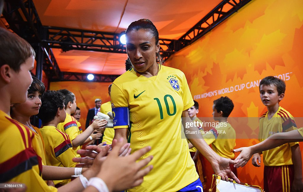 <a gi-track='captionPersonalityLinkClicked' href=/galleries/search?phrase=Marta+-+Soccer+Player&family=editorial&specificpeople=3038337 ng-click='$event.stopPropagation()'>Marta</a> of Brazil greets the player escort children during the FIFA Women's World Cup 2015 group E match between Brazil and Korea Republic at Olympic Stadium on June 9, 2015 in Montreal, Canada