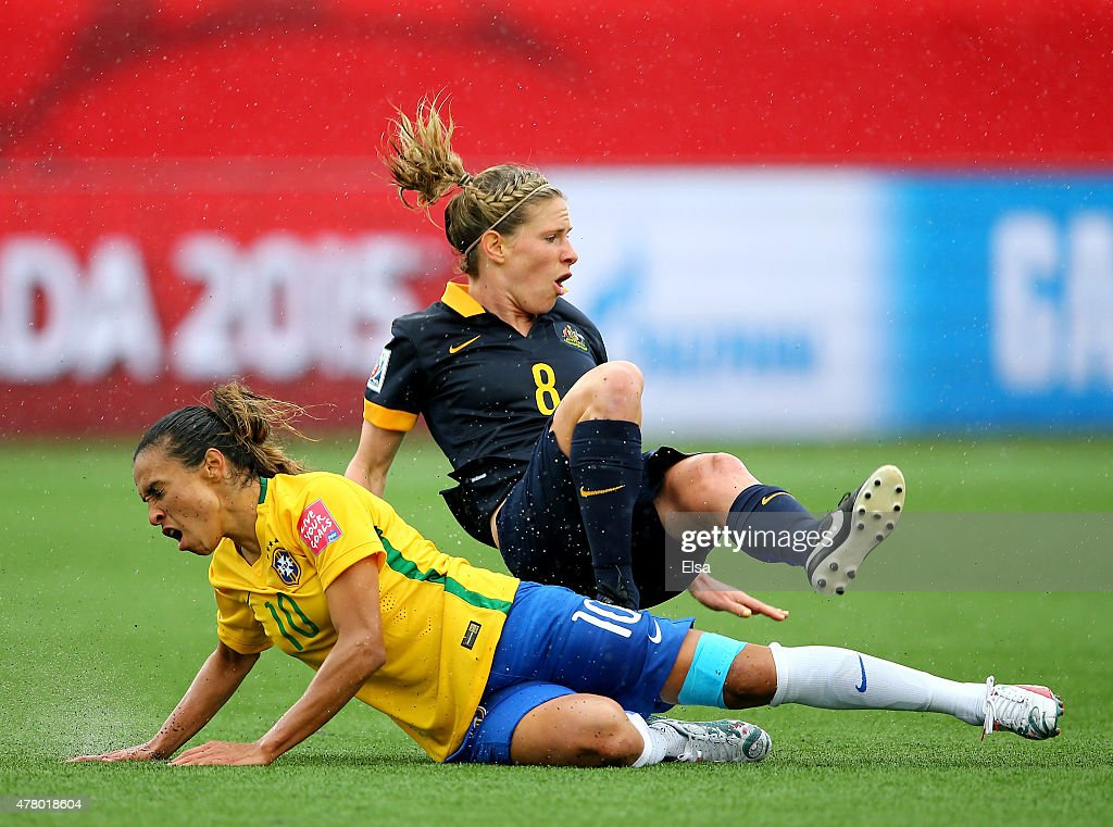 <a gi-track='captionPersonalityLinkClicked' href=/galleries/search?phrase=Marta+-+Soccer+Player&family=editorial&specificpeople=3038337 ng-click='$event.stopPropagation()'>Marta</a> #10 of Brazil is given a yellow card on this tackle as <a gi-track='captionPersonalityLinkClicked' href=/galleries/search?phrase=Elise+Kellond-Knight&family=editorial&specificpeople=5608024 ng-click='$event.stopPropagation()'>Elise Kellond-Knight</a> #8 of Australia falls during the FIFA Women's World Cup 2015 round of 16 match between Brazil and Australia at Moncton Stadium on June 21, 2015 in Moncton, Canada.