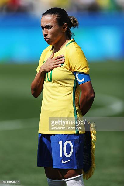 Marta of Brazil lines up for the national anthems before the Women's Olympic Football Bronze Medal match between Brazil and Canada at Arena...