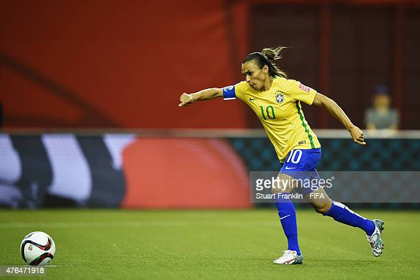 Marta of Brazil scores her penalty goal during the FIFA Women's World Cup 2015 group E match between Brazil and Korea Republic at Olympic Stadium on...
