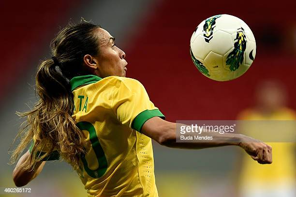 Marta of Brazil struggles for the ball during a match between Brazil and Argentina as part of International Women's Football Tournament of Brasilia...