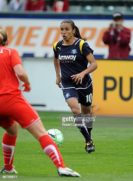 Marta of the Los Angeles Sol looks to set up the attack during their inaugural WPS match against the Washington Freedom at The Home Depot Center on...