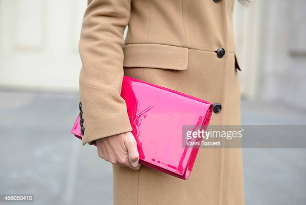 Marta Pozzan poses wearing a Tommy Hilfiger coat and YSL bag on September 24 2014 in Paris France