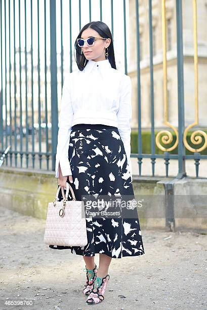 Marta Pozzan poses wearing an Audra shirt Dior bag Banana Republic skirt and Sophie Webster shoes on Day 4 of Paris Fashion Week Womenswear FW15 on...