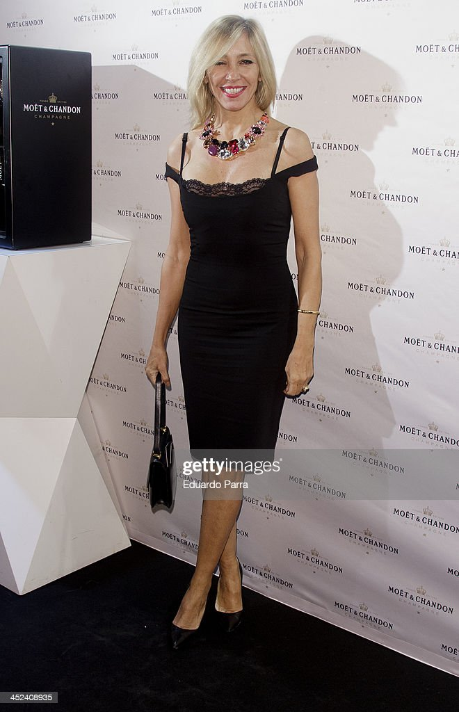 <a gi-track='captionPersonalityLinkClicked' href=/galleries/search?phrase=Marta+Robles&family=editorial&specificpeople=2201316 ng-click='$event.stopPropagation()'>Marta Robles</a> attends 'Moet Golden Glass' party photocall at Le Boutique on November 28, 2013 in Madrid, Spain.
