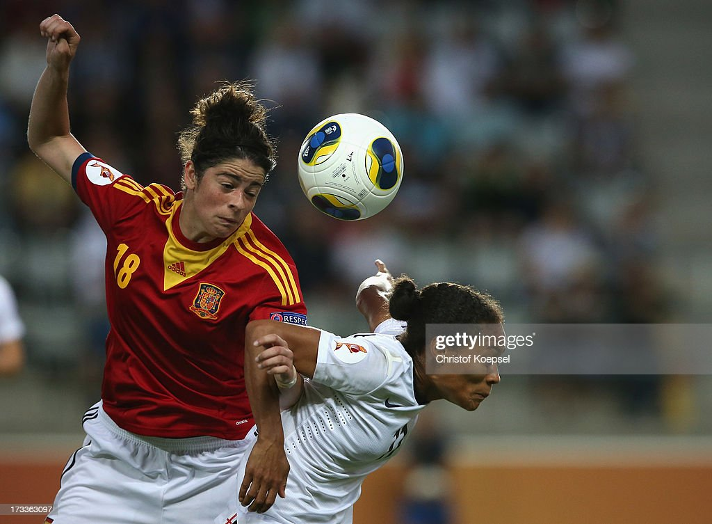 Marta Torrejon of Spain and Rachel Yankey of England go up for a header during the UEFA Women's EURO 2013 Group C match between England and Spain at Linkoping Arena on July 12, 2013 in Linkoping, Sweden.