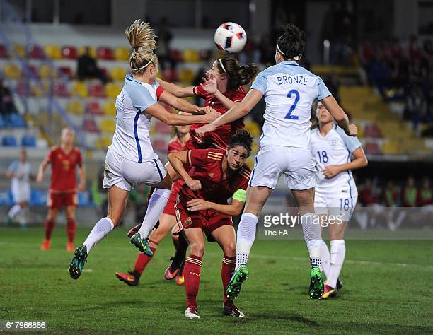 Marta Torrejon of Spain is challenged by Lucy Bronze of England during the Spain Women v England Women International Friendly match at Estadio...