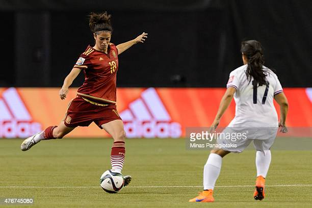 Marta Torrejon of Spain plays the ball near Karla Villalobos of Costa Rica during the 2015 FIFA Women's World Cup Group E match at Olympic Stadium on...