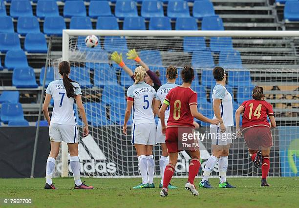 Marta Torrejon of Spain scores her team's opening goal from a free kick during the Spain Women v England Women International Friendly match at...