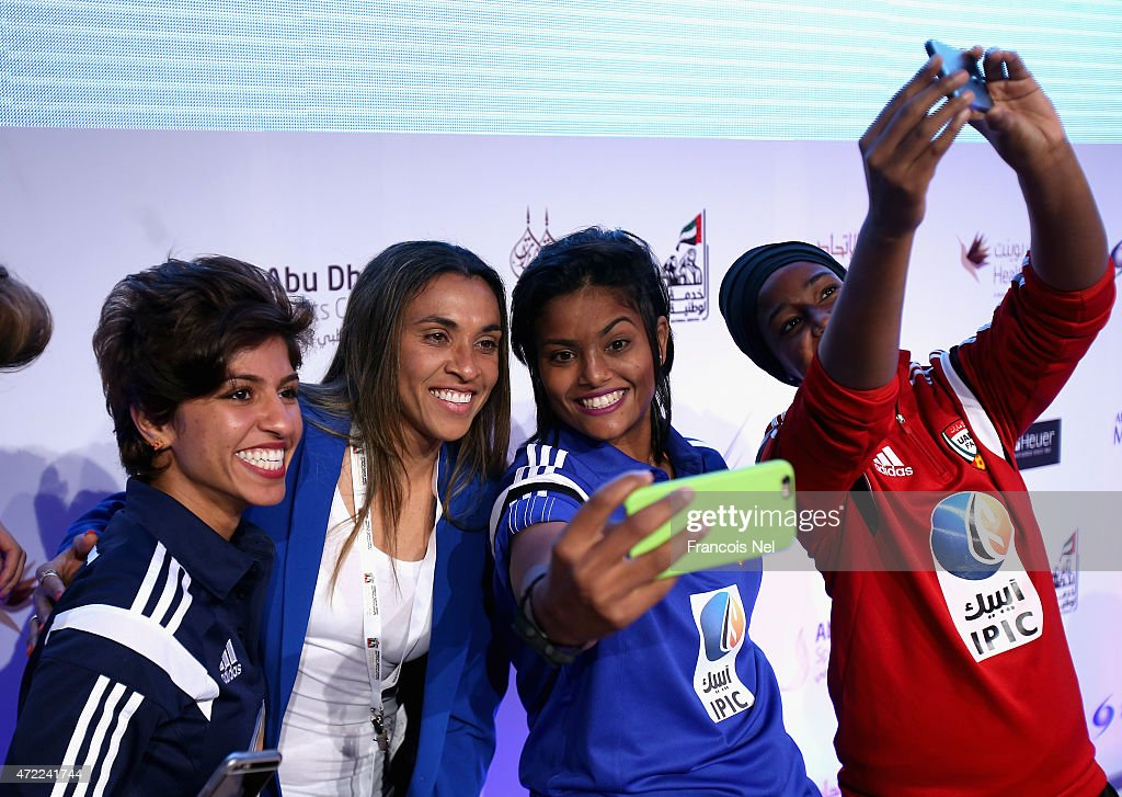 <a gi-track='captionPersonalityLinkClicked' href=/galleries/search?phrase=Marta+-+Soccer+Player&family=editorial&specificpeople=3038337 ng-click='$event.stopPropagation()'>Marta</a> Viera Da Silva of Brazil poses for a selfie with players of the UAE Women's Football team during the Third International Sports Conference for Women at Emirates Palace on May 5, 2015 in Abu Dhabi, United Arab Emirates.