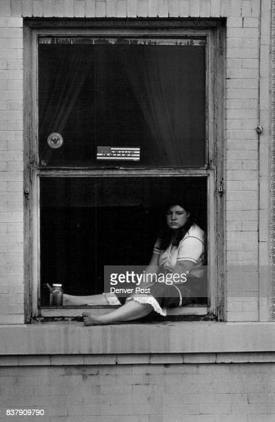 SEP 25 '82 SEP 26 1982 Marta Wood and eighteenyearold who recently moved to Denver from California to find a job sat in her apartment window at the...