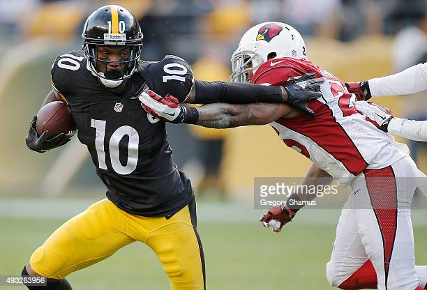Martavis Bryant of the Pittsburgh Steelers attempts to evade a tackle against the Arizona Cardinals during the game at Heinz Field on October 18 2015...