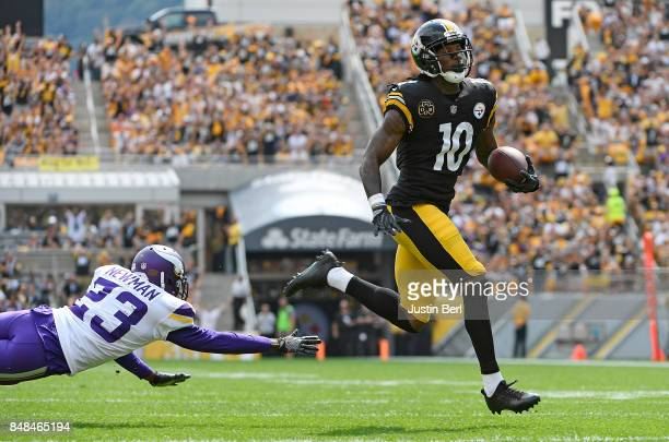 Martavis Bryant of the Pittsburgh Steelers avoid a tackle by Terence Newman of the Minnesota Vikings as he heads to the end zone for a 27 yard...