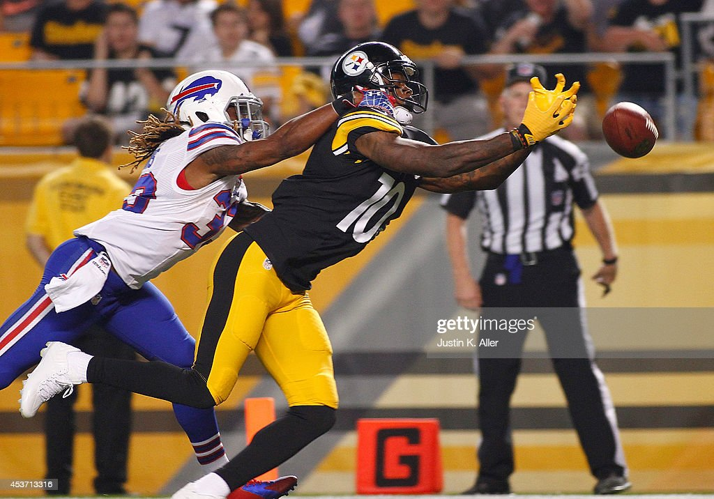 <a gi-track='captionPersonalityLinkClicked' href=/galleries/search?phrase=Martavis+Bryant&family=editorial&specificpeople=8330050 ng-click='$event.stopPropagation()'>Martavis Bryant</a> #10 of the Pittsburgh Steelers can't make a catch in front of <a gi-track='captionPersonalityLinkClicked' href=/galleries/search?phrase=Ron+Brooks&family=editorial&specificpeople=597392 ng-click='$event.stopPropagation()'>Ron Brooks</a> #33 of the Buffalo Bills during the third quarter at Heinz Field on August 16, 2014 in Pittsburgh, Pennsylvania.