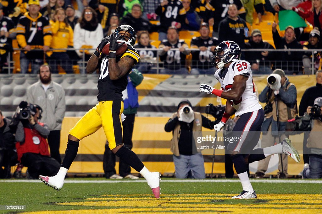 <a gi-track='captionPersonalityLinkClicked' href=/galleries/search?phrase=Martavis+Bryant&family=editorial&specificpeople=8330050 ng-click='$event.stopPropagation()'>Martavis Bryant</a> #10 of the Pittsburgh Steelers catches a 35 yards touchdown pass in the second quarter against <a gi-track='captionPersonalityLinkClicked' href=/galleries/search?phrase=Andre+Hal&family=editorial&specificpeople=8281332 ng-click='$event.stopPropagation()'>Andre Hal</a> #29 of the Houston Texans during their game at Heinz Field on October 20, 2014 in Pittsburgh, Pennsylvania.