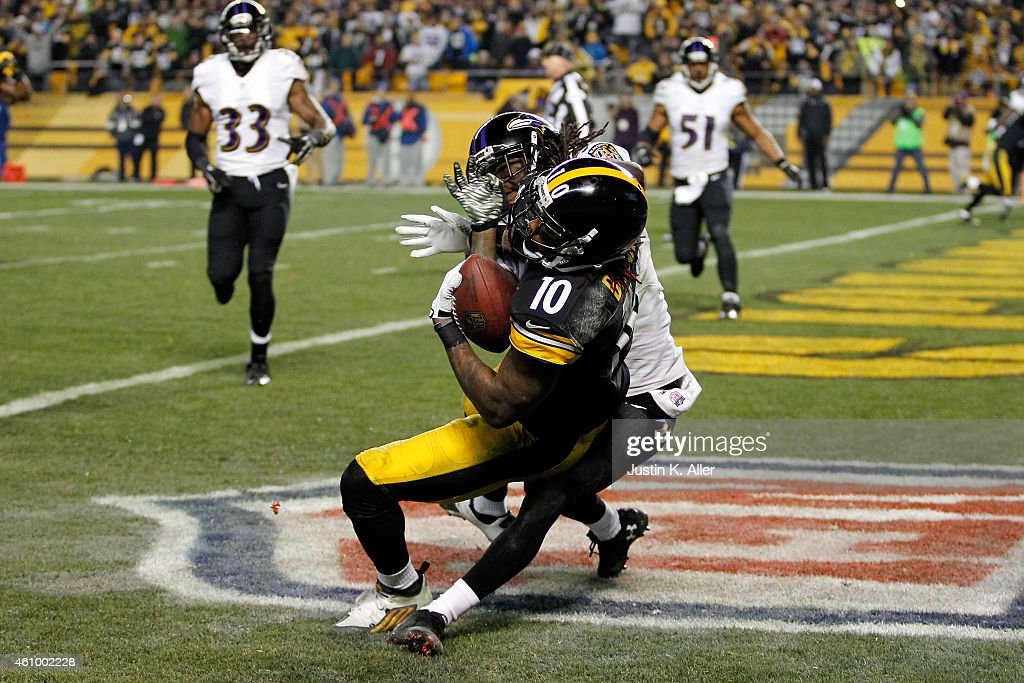 <a gi-track='captionPersonalityLinkClicked' href=/galleries/search?phrase=Martavis+Bryant&family=editorial&specificpeople=8330050 ng-click='$event.stopPropagation()'>Martavis Bryant</a> #10 of the Pittsburgh Steelers catches a fourth quarter touchdown as <a gi-track='captionPersonalityLinkClicked' href=/galleries/search?phrase=Lardarius+Webb&family=editorial&specificpeople=5735454 ng-click='$event.stopPropagation()'>Lardarius Webb</a> #21 of the Baltimore Ravens defends during their AFC Wild Card game at Heinz Field on January 3, 2015 in Pittsburgh, Pennsylvania.