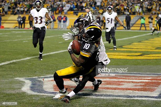 Martavis Bryant of the Pittsburgh Steelers catches a fourth quarter touchdown as Lardarius Webb of the Baltimore Ravens defends during their AFC Wild...
