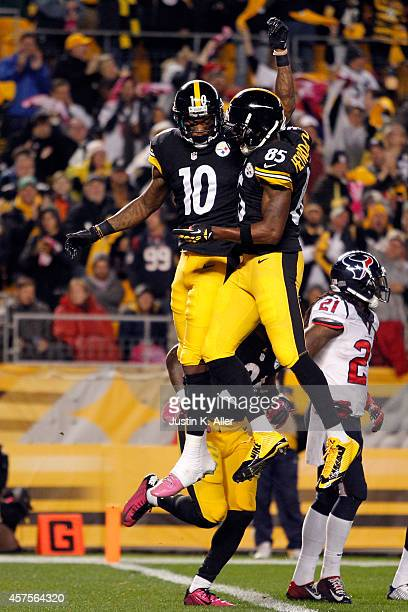 Martavis Bryant of the Pittsburgh Steelers celebrates with Darrius HeywardBey after catching a 35 yards touchdown pass in the second quarter against...