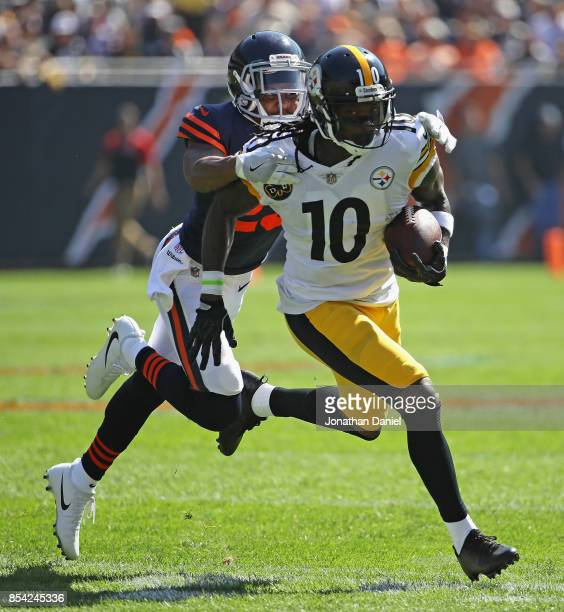 Martavis Bryant of the Pittsburgh Steelers is grabbed by Kyle Fuller of the Chicago Bears at Soldier Field on September 24 2017 in Chicago Illinois...