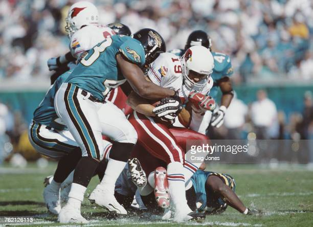 MarTay Jenkins Wide Receiver for the Arizona Cardinals is tackled by Jermaine Williams during the American Football Conference Central game against...