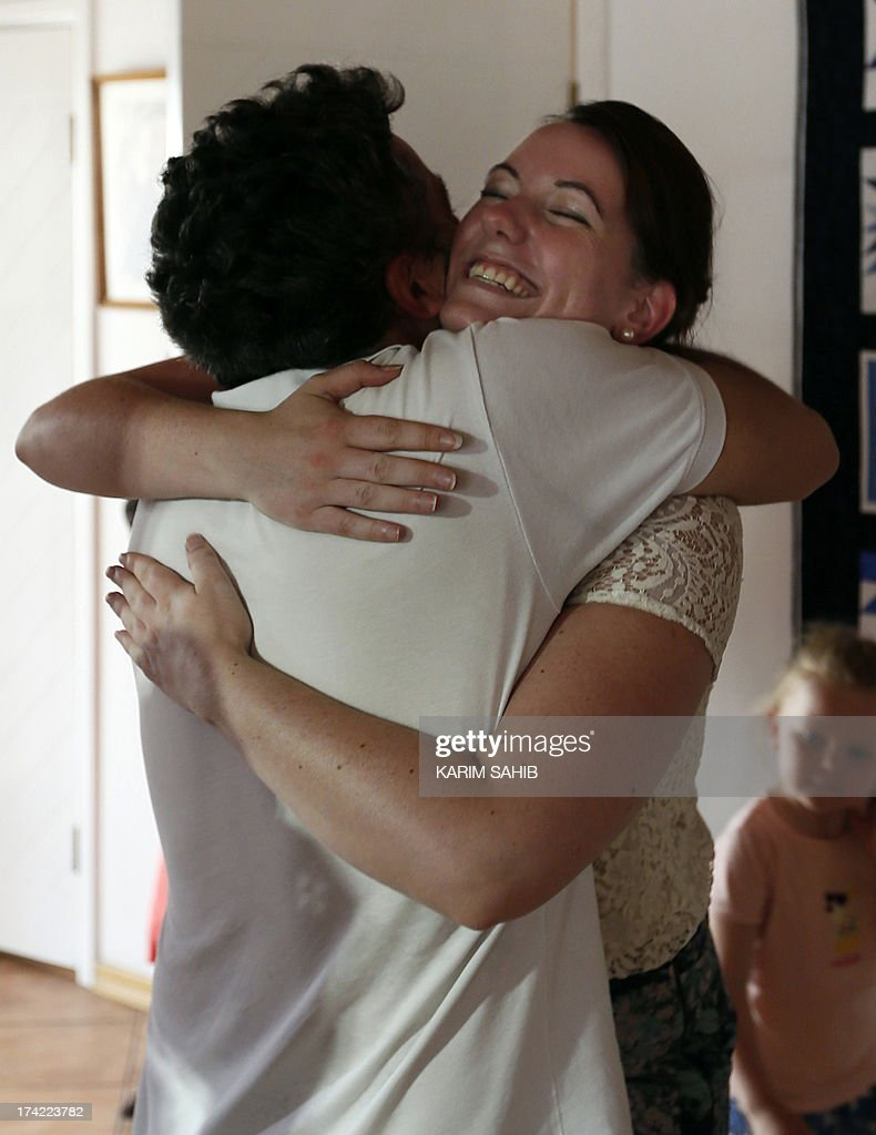 Marte Dalelv (R) from Norway, is congratulated by an unidentified Norwegian journalist at the Norwegian Seamen's Center in Dubai, on July 22, 2013 after she was pardoned by Dubai ruler Sheikh Mohammed bin Rashid al-Maktoum of an extramarital sex charge and allowed to fly home. Dalelv, 24, risked 16 months in jail after being convicted last week by a Dubai court of extramarital sex, perjury and consuming alcohol without licence after she reported being raped by a co-worker in the UAE.