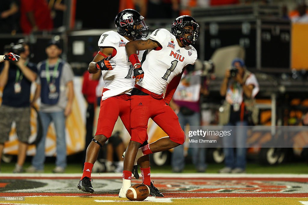 Martel Moore #1 of the Northern Illinois Huskies celebrates after he scored a 11-yard touchdown reception in the third quarter against the Florida State Seminoles during the Discover Orange Bowl at Sun Life Stadium on January 1, 2013 in Miami Gardens, Florida.