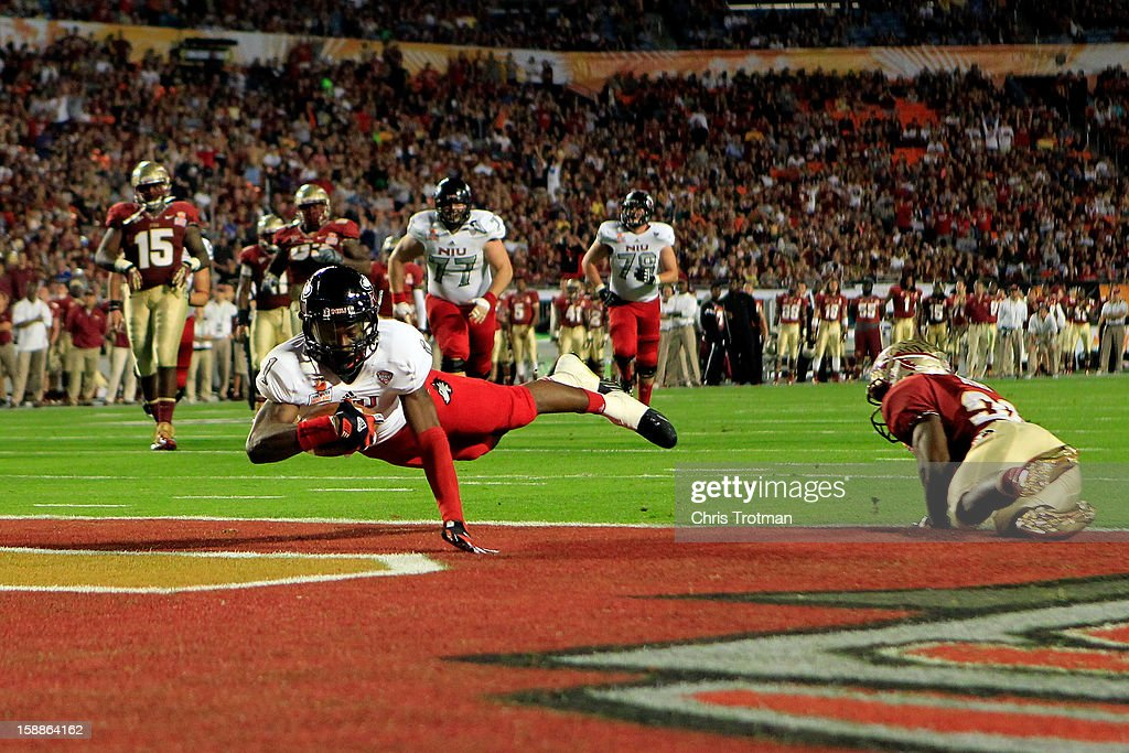 Martel Moore #1 of the Northern Illinois Huskies scores an 11-yard touchdown reception in the third quarter against Lamarcus Joyner #20 of the Florida State Seminoles during the Discover Orange Bowl at Sun Life Stadium on January 1, 2013 in Miami Gardens, Florida.
