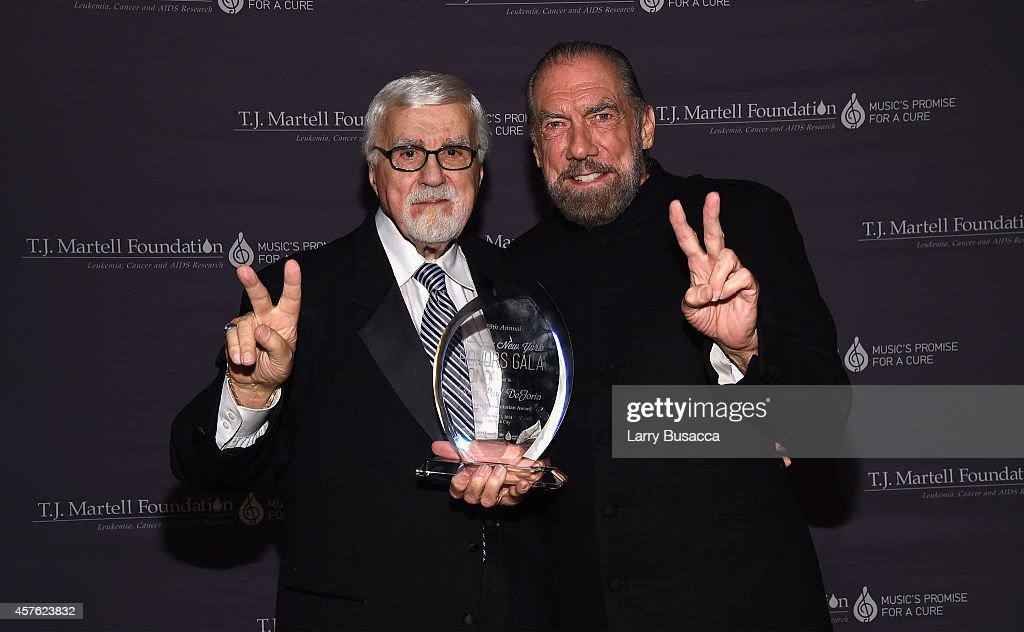 T.J. Martell Foundation founder and chairman Tony Martell (L) and Co-Founder, Chairman and CEO of John Paul Mitchell Systems (JPMS) and Co-Founder of Patron Tequila and Spirits John Paul DeJoria pose backstage at the T.J. Martell Foundation's 39th Annual New York Honors Gala at Cipriani 42nd Street on October 21, 2014 in New York City.