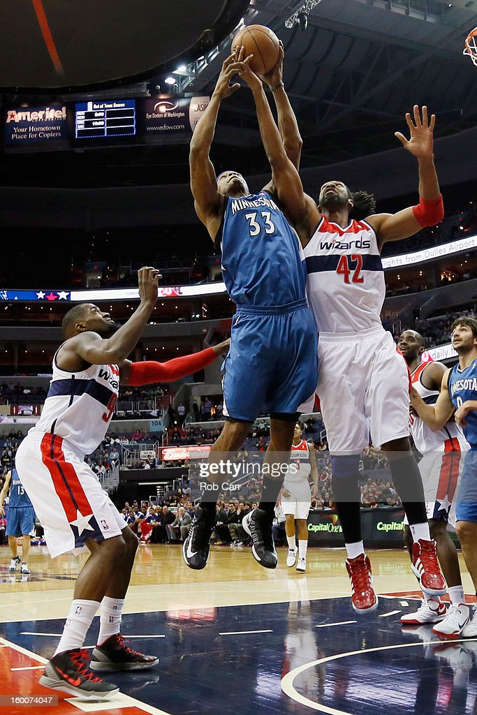 Martell Webster #9 and Nenê #42 of the Washington Wizards go up for a rebound against Dante Cunningham #33 of the Minnesota Timberwolves during the first half at Verizon Center on January 25, 2013 in Washington, DC.