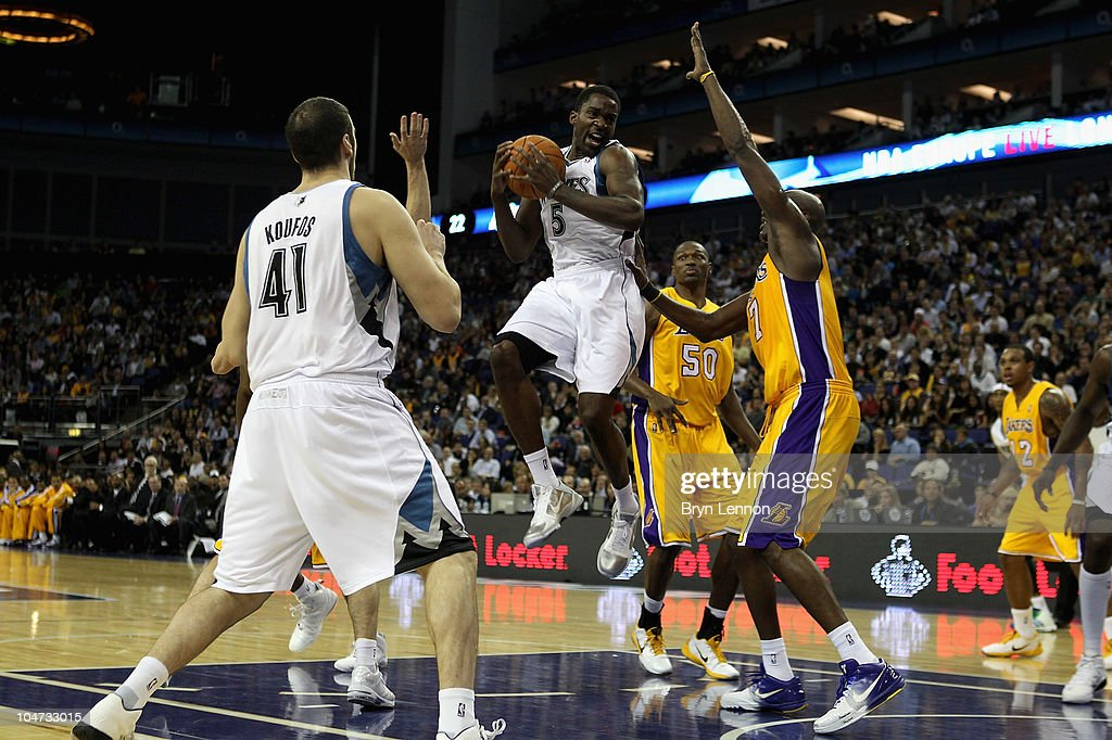 <a gi-track='captionPersonalityLinkClicked' href=/galleries/search?phrase=Martell+Webster&family=editorial&specificpeople=601785 ng-click='$event.stopPropagation()'>Martell Webster</a> of the Minnesota Timberwolves (C) in action during the NBA Europe Live match between the Los Angeles Lakers and the Minnesota Timberwolves at the O2 arena on October 4, 2010 in London, England.