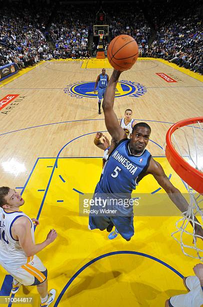 Martell Webster of the Minnesota Timberwolves soars through the air for a dunk against David Lee of the Golden State Warriors on March 13 2011 at...