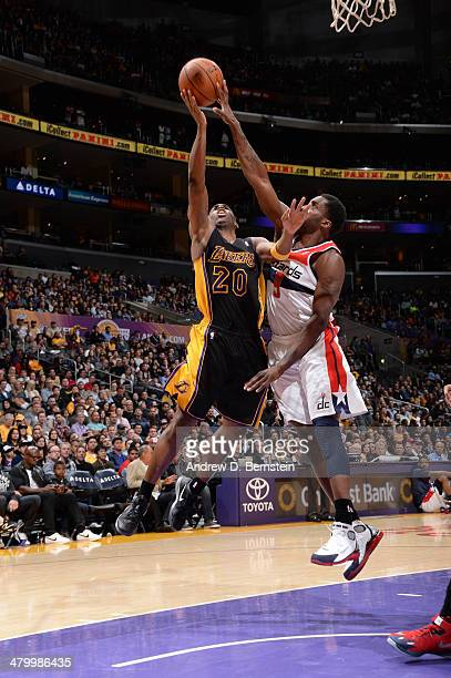 Martell Webster of the Washington Wizards blocks a shot against Jodie Meeks of the Los Angeles Lakers at Staples Center on March 21 2014 in Los...