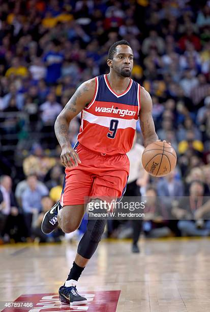 Martell Webster of the Washington Wizards dribbles the ball up court against the Golden State Warriors at ORACLE Arena on March 23 2015 in Oakland...