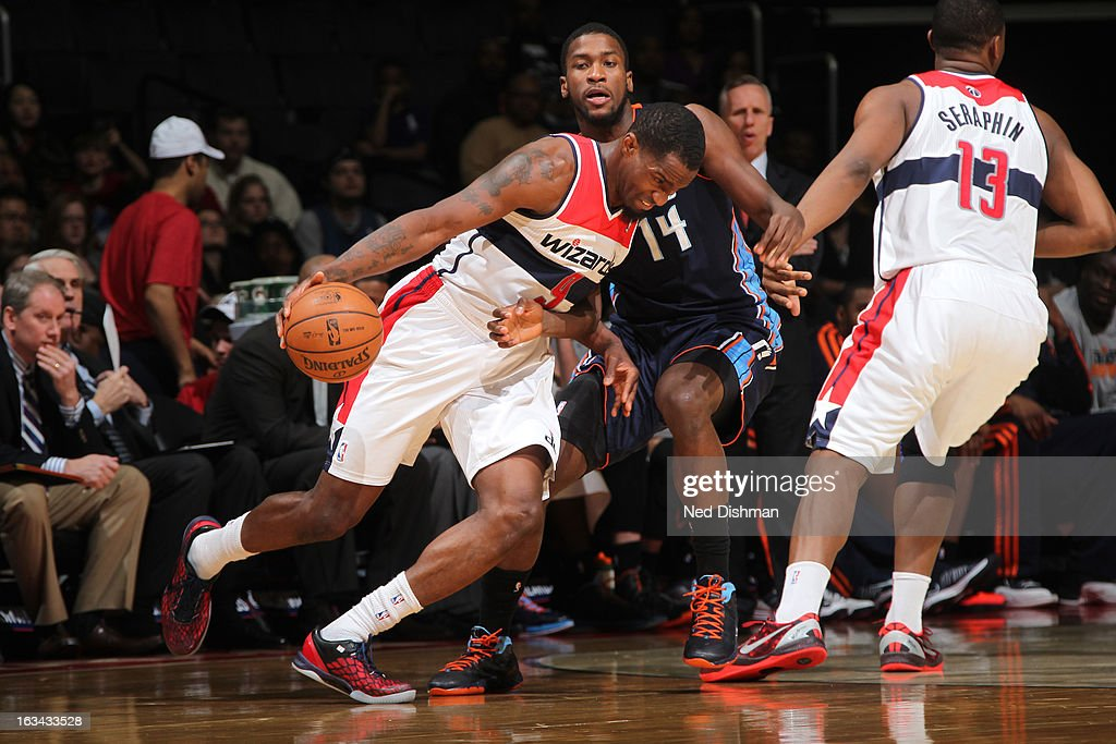 Martell Webster #9 of the Washington Wizards drives against Michael Kidd-Gilchrist #14 of the Charlotte Bobcats during the game at the Verizon Center on March 9, 2013 in Washington, DC.