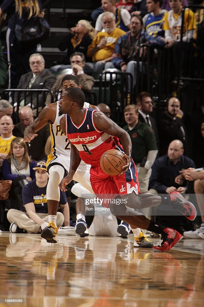 Martell Webster #9 of the Washington Wizards drives against Paul George #24 of the Indiana Pacers on January 2, 2013 at Bankers Life Fieldhouse in Indianapolis, Indiana.