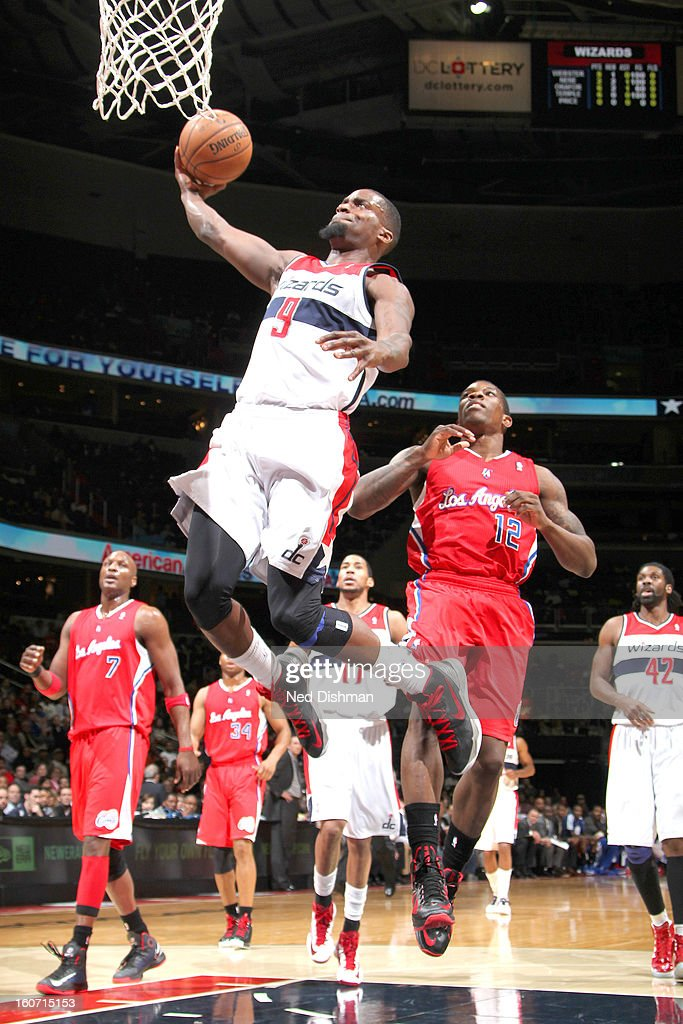 Martell Webster #9 of the Washington Wizards dunks against Eric Bledsoe #12 of the Los Angeles Clippers during the game at the Verizon Center on February 4, 2013 in Washington, DC.