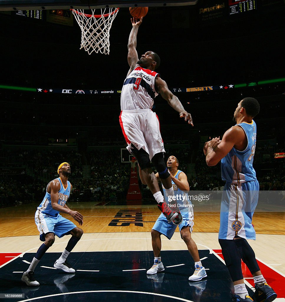 <a gi-track='captionPersonalityLinkClicked' href=/galleries/search?phrase=Martell+Webster&family=editorial&specificpeople=601785 ng-click='$event.stopPropagation()'>Martell Webster</a> #9 of the Washington Wizards dunks against <a gi-track='captionPersonalityLinkClicked' href=/galleries/search?phrase=JaVale+McGee&family=editorial&specificpeople=4195625 ng-click='$event.stopPropagation()'>JaVale McGee</a> #34 of the Denver Nuggets during the game at the Verizon Center on February 22, 2013 in Washington, DC.