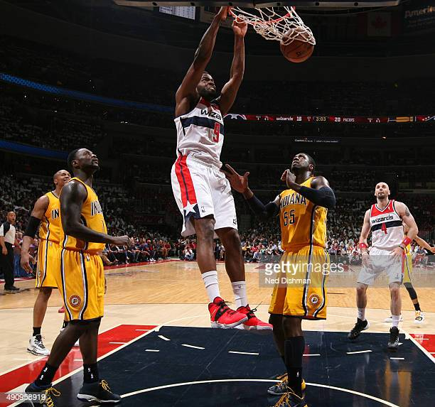 Martell Webster of the Washington Wizards dunks against Roy Hibbert of the Indiana Pacers in Game Six of the Eastern Conference Semifinals during the...