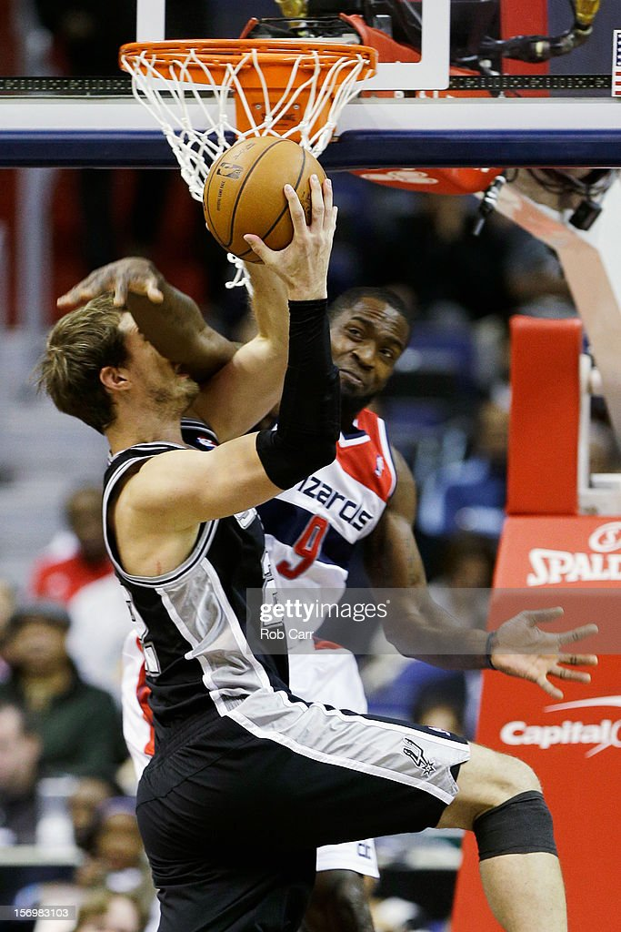 <a gi-track='captionPersonalityLinkClicked' href=/galleries/search?phrase=Martell+Webster&family=editorial&specificpeople=601785 ng-click='$event.stopPropagation()'>Martell Webster</a> #9 of the Washington Wizards fouls <a gi-track='captionPersonalityLinkClicked' href=/galleries/search?phrase=Tiago+Splitter&family=editorial&specificpeople=208218 ng-click='$event.stopPropagation()'>Tiago Splitter</a> #22 of the San Antonio Spurs during the first half at Verizon Center on November 26, 2012 in Washington, DC.