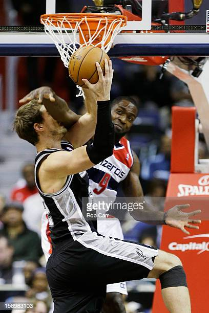 Martell Webster of the Washington Wizards fouls Tiago Splitter of the San Antonio Spurs during the first half at Verizon Center on November 26 2012...