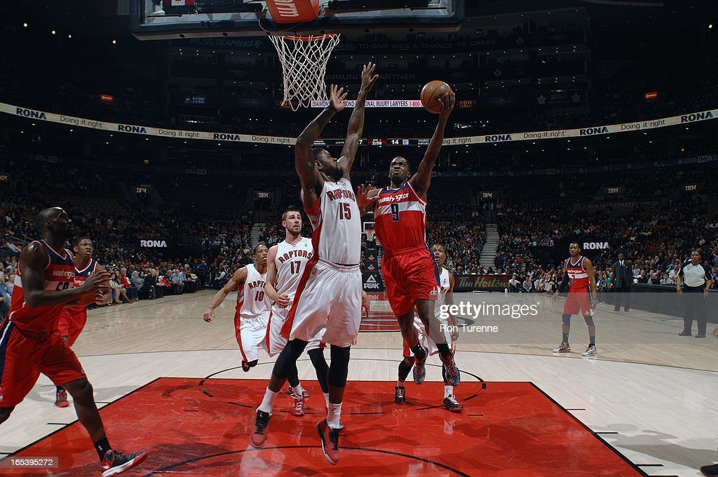 Martell Webster #9 of the Washington Wizards glides to the hoop against Amir Johnson #15 of the Toronto Raptors during the game on April 3, 2013 at the Air Canada Centre in Toronto, Ontario, Canada.